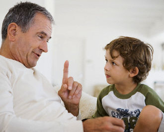 Grandfather and grandson --- Image by © Olix Wirtinger/Corbis
