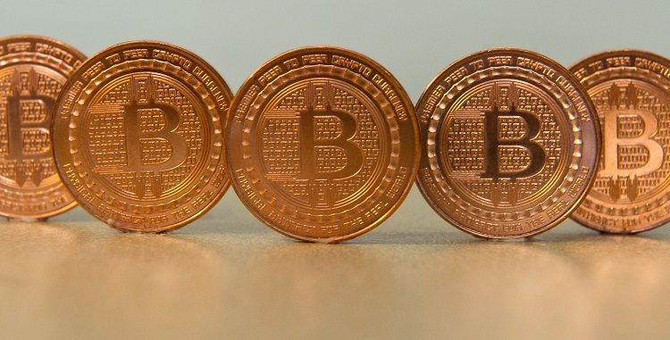 (FILES) This file photo taken on June 17, 2014, in Washington, DC, shows bitcoin medals. Bitcoin makes its debut on a major exchange on December 10, 2017, a milestone for the digital currency that has some investors excited but others nervous. The Cboe Futures Exchange in Chicago will open trading in bitcoin futures at 2300 GMT on Sunday, a move that is expected to be followed a week later by a rival listing on Chicago Mercantile Exchange. / AFP / KAREN BLEIER