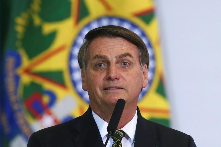 Jair Bolsonaro durante uma cerimônia para comemorar os 300 dias do governo Bolsonaro no Palácio do Planalto, em Brasília (Crédito: AFP)